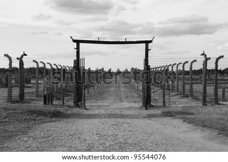 Barbed wire electrical fence at Auschwitz Birkenau, Poland - stock photo