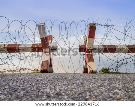 Barbed wire fence block the way - stock photo