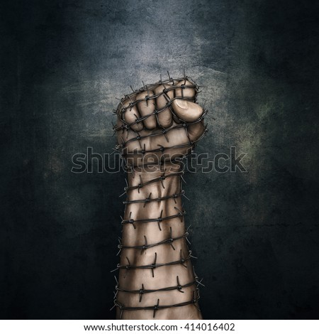 Barbed wire fist / 3D illustration of grungy raised fist wrapped in barbed wire against dark stone background - stock photo