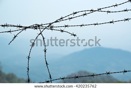 barbed wire on landscape background
