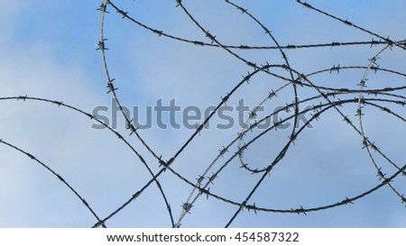 Barbed wire over blue sky and clouds background - 3D illustration