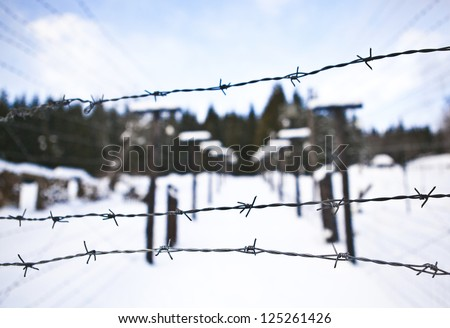 Barbed wire, remains of iron curtain on Czech-German border in winter with snow - stock photo