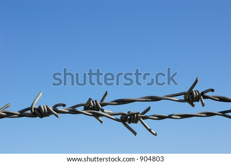 Barbed wire with sky on the background