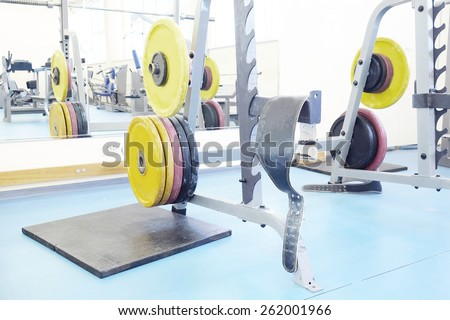 Barbel weights in gym - stock photo