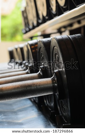 barbel weights in gym building in thailand - stock photo