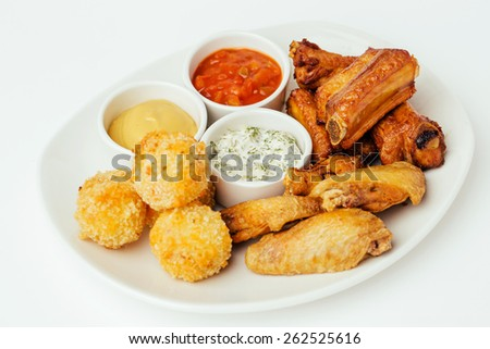 Barbeque pork spare ribs, Cheese Ball and  chicken wings served at a restaurant - stock photo