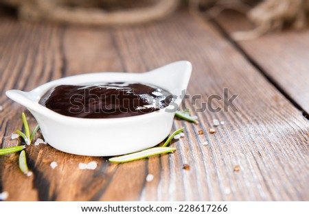 Barbeque Sauce with Tomatoes, Smoked Salt and fresh Herbs (on rustic wooden background) - stock photo