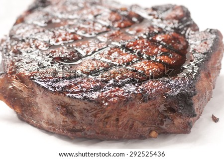 barbequed beef rib steak grilled to perfection with salad and potato