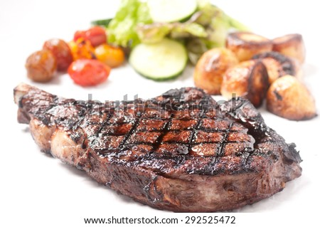 barbequed beef rib steak grilled to perfection with salad and potato - stock photo