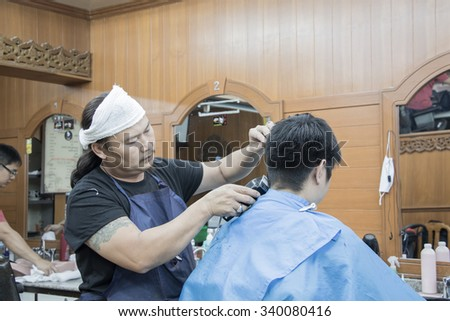 Barber Asians working with machine.