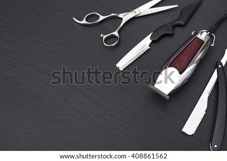 Barber shop equipment on Black background with place for text.  Professional hairdressing tools. Comb, scissor, clippers and hair trimmer isolated.  - stock photo