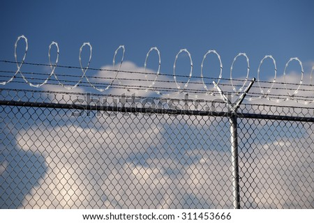 Barbwire boundary, fence - stock photo