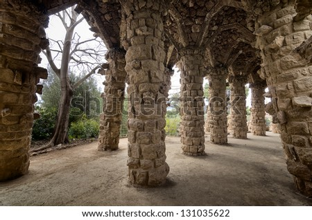 Barcelona: Amazing stone arches at Park Guell, the famous and beautiful park designed by Antoni Gaudi, one of the highlights of the city - stock photo