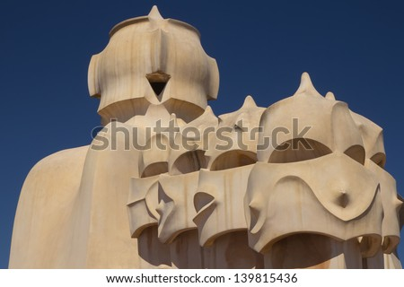 BARCELONA. APR 24: Casa Mila. On the rooftop there are twenty-eight chimneys in several groupings  twisted so that the smoke came out better.  2013 in Barcelona, Spain. - stock photo