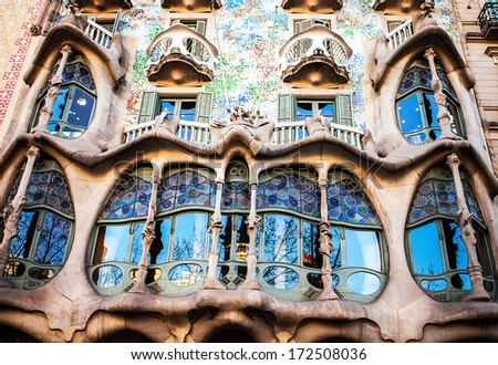 BARCELONA - APR 24: Casa Mila or La Pedrera on April 24, 2012 in Barcelona, Spain. This famous building was designed by Antoni Gaudi and is one of the most visited of the city - stock photo