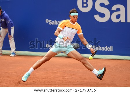 BARCELONA - APR 22: Rafa Nadal (Spanish tennis player) plays at the ATP Barcelona Open Banc Sabadell Conde de Godo tournament on April 22, 2015 in Barcelona, Spain. - stock photo