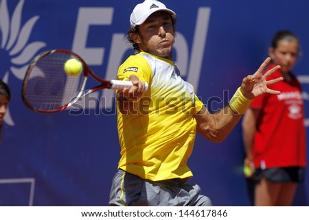 BARCELONA  - APRIL, 24: Argentinian tennis player Juan Monaco in action during a match of Barcelona tennis tournament Conde de Godo on April 24, 2013 in Barcelona - stock photo