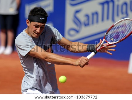 BARCELONA - APRIL, 24: Australian tennis player Bernard Tomic in action during his match against Ernests Gulbis  of Barcelona tennis tournament Conde de Godo on April 24, 2012 in Barcelona - stock photo