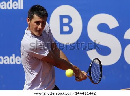 BARCELONA - APRIL, 23: Australian tennis player Bernard Tomic in action during his match against Kenny de Schepper of Barcelona tennis tournament Conde de Godo on April 23, 2013 in Barcelona - stock photo
