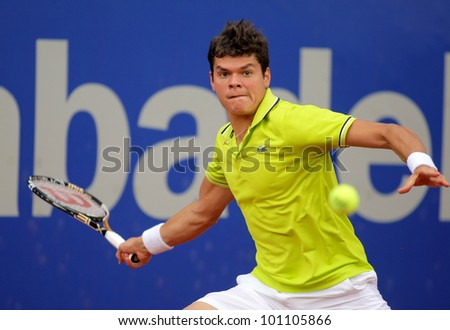 BARCELONA - APRIL, 25: Canadian tennis player Milos Raonic in action during his match against Igor Andreev of Barcelona tennis tournament Conde de Godo on April 25, 2012 in Barcelona - stock photo