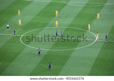 Barcelona April 05 - 2016: Football players are waiting to start the game in Camp Nou stadium on Champions league match between FC Barcelona and Atletico Madrid, April 05, 2016, in Barcelona, Spain. - stock photo