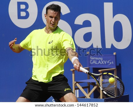 BARCELONA - APRIL, 23: French tennis player Kenny de Schepper in action during a match of Barcelona tennis tournament Conde de Godo on April 23, 2013 in Barcelona - stock photo