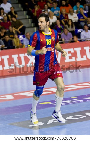 BARCELONA - APRIL 24: Iker Romero (18) of Barcelona during the handball Champions League match between FC Barcelona and THW Kiel, final score 27 - 25 on April 24, 2011 in Barcelona, Spain.