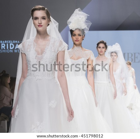 BARCELONA - APRIL 29: models walking on the Cymbeline bridal collection 2017 catwalk during the Barcelona Bridal Fashion Week runway on April 29, 2016 in Barcelona, Spain.  - stock photo