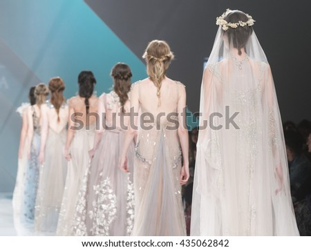 BARCELONA - APRIL 28: models walking on the Marco & Maria bridal collection 2017 catwalk during the Barcelona Bridal Fashion Week runway on April 28, 2016 in Barcelona, Spain.  - stock photo