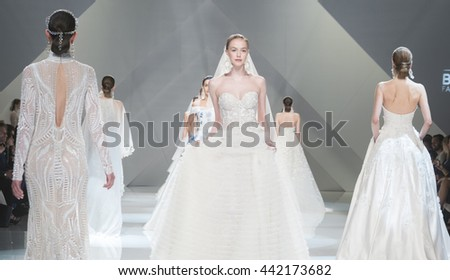 BARCELONA - APRIL 27: models walking on the Naeem Khan bridal collection 2017 catwalk during the Barcelona Bridal Fashion Week runway on April 27, 2016 in Barcelona, Spain.  - stock photo