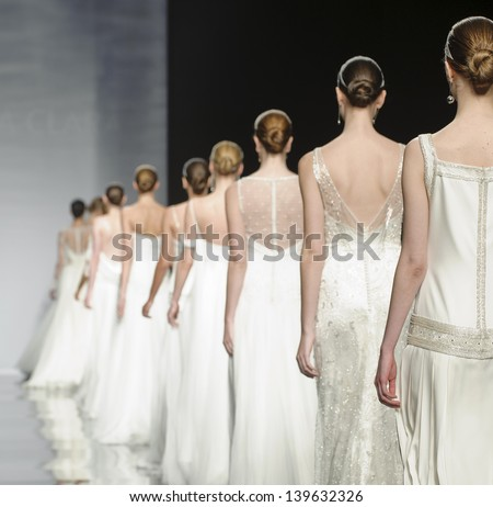 BARCELONA - APRIL 30: Models walking on the Rosa Clara catwalk during the Barcelona Bridal Week runway on April 30, 2013 in Barcelona, Spain. - stock photo