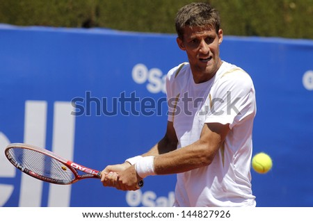BARCELONA - APRIL, 24: Slovak tennis player Martin Klizan during a match of Barcelona tennis tournament Conde de Godo on April 24, 2013 in Barcelona - stock photo
