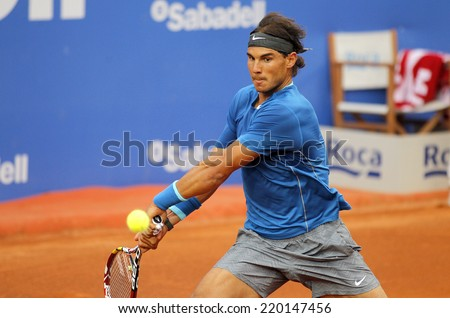 BARCELONA - APRIL, 24: Spanish tennis player Rafa Nadal in action during a match of Barcelona tennis tournament Conde de Godo on April 24, 2014 in Barcelona - stock photo