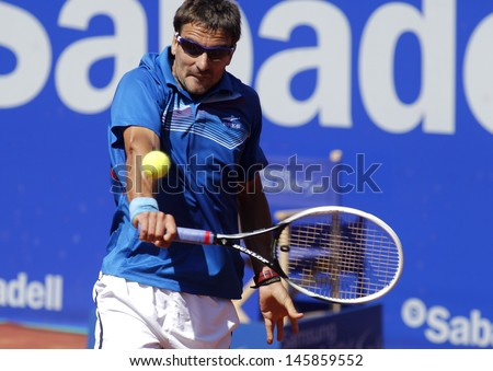 BARCELONA - APRIL, 24: Spanish tennis player Tommy Robredo in action during a match of Barcelona tennis tournament Conde de Godo on April 24, 2013 in Barcelona - stock photo