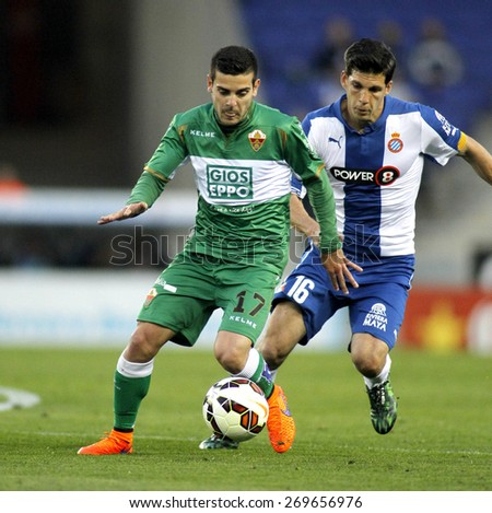 BARCELONA - APRIL, 6: Victor Rodriguez of Elche CF during a Spanish League match against RCD Espanyol at the Estadi Cornella on April 6, 2015 in Barcelona, Spain - stock photo