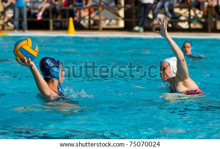 BARCELONA - APRIL 10: Water polo players in action during the women Spanish league match between CN Mataro and Sant Andreu, final score 4 - 7.on April 10, 2011 in Mataro, Barcelona, Spain.