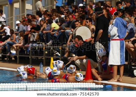 BARCELONA - APRIL 10: Waterpolo players of Mataro team during the women Spanish league match between CN Mataro and Sant Andreu, final score 4 - 7. April 10, 2011 in Mataro (Spain). - stock photo