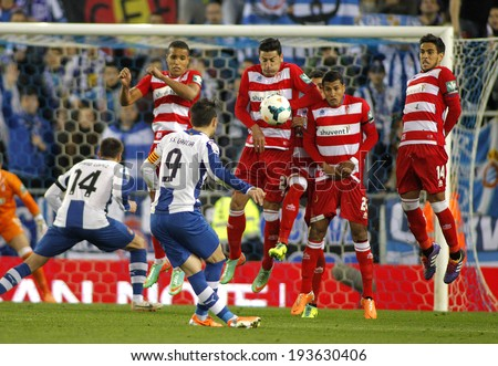 BARCELONA-APRL, 27: UD Almeria players on the wall of the free kick launched by Sergio Graica of RCD Espanyol during a Spanish League match at the Estadi Cornella on April 27, 2014 in Barcelona, Spain - stock photo