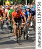 BARCELONA - AUG, 26: Euskaltel-Euskadi spanish cyclist Igor Anton rides with the pack during the Vuelta Ciclista a Espana cycling race in Barcelona on August 26, 2012 - stock photo