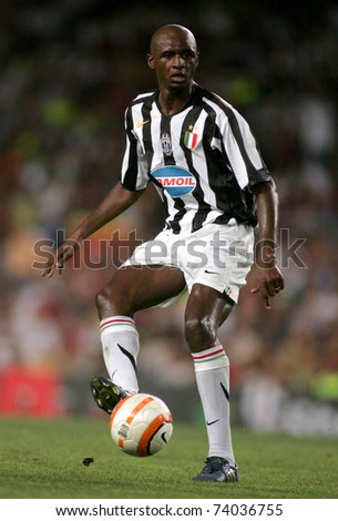 BARCELONA - AUG 24: French player Patrick Vieria of Juventus in action during the friendly match between Barcelona and Juventus at Nou Camp Stadium August 24, 2005 in Barcelona, Spain - stock photo