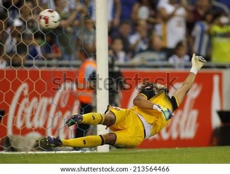 BARCELONA - AUG, 17: Mattia Perin of Genoa CFC in action during a friendly match against RCD Espanyol at the Estadi Cornella on August 17, 2014 in Barcelona, Spain - stock photo