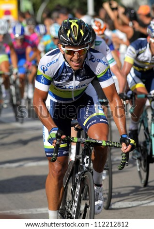 BARCELONA - AUG 26: Orica Greenedge Australian cyclist Allan Davis rides with the pack during the Vuelta Ciclista a Espana cycling race in Barcelona on August 26, 2012