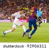 BARCELONA - AUGUST 17: Angel Di Maria (L) in action during the Spanish Super Cup final match between FC Barcelona and Real Madrid, 3 - 2, on August 17, 2011 in Camp Nou stadium, Barcelona, Spain. - stock photo