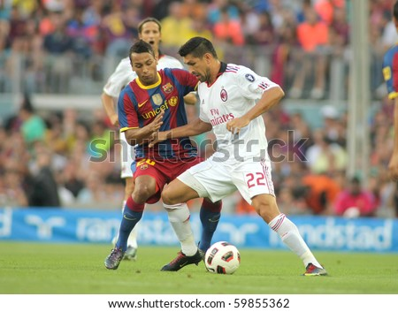 BARCELONA - AUGUST 25: Borriello(R) of Milan fight with Jeffren(L) of Barcelona during Trophy Joan Gamper match between FC Barcelona and Milan at Nou Camp Stadium August 25, 2010 in Barcelona, Spain.