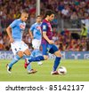 BARCELONA - AUGUST 22: Cesc Fabregas (R) and Gokhan Inler (L) during the Gamper Trophy match between FC Barcelona and SSC Napoli, 5 - 0, on August 22, 2011 in Camp Nou stadium, Barcelona, Spain. - stock photo