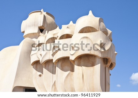 BARCELONA-AUGUST 29 2010:Gaudi designed chimneys at Casa Mila (known as La Pedrera)in Barcelona on August 29 2010. Terrace of Casa Mila  with chimneys shaped like soldiers, created by Antoni Gaudi.