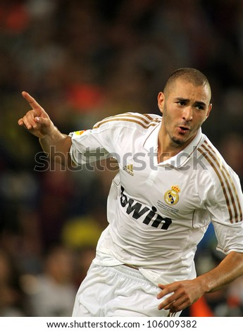 BARCELONA - AUGUST 17:Karim Benzema of Real Madrid celebrating goal during the Spanish Supercup football match between Barcelona vs Real Madrid at the New Camp Stadium in Barcelona, on August 17, 2011 - stock photo