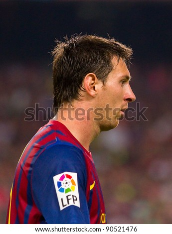 BARCELONA - AUGUST 17: Lionel Messi in action during the Spanish Super Cup final match between FC Barcelona and Real Madrid, 3 - 2, on August 17, 2011 in Barcelona, Spain. - stock photo