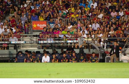 BARCELONA - AUGUST 22: pep Guardiola (grey shirt) during the Gamper Trophy final match between FC Barcelona and Napoli, final score 5 - 0, on August 22, 2011 in Camp Nou stadium, Barcelona, Spain.
