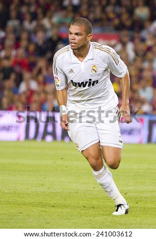BARCELONA - AUGUST 17: Pepe Laveran of RM  in action at the Spanish Super Cup final match between FC Barcelona and Real Madrid, 3 - 2, on August 17, 2011 in Camp Nou stadium, Barcelona, Spain. - stock photo